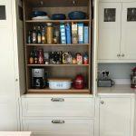 Larder with Slide and Hide Pocket Doors, Oak Interior and External Drawers. Stepped Shaker In-frame Doors